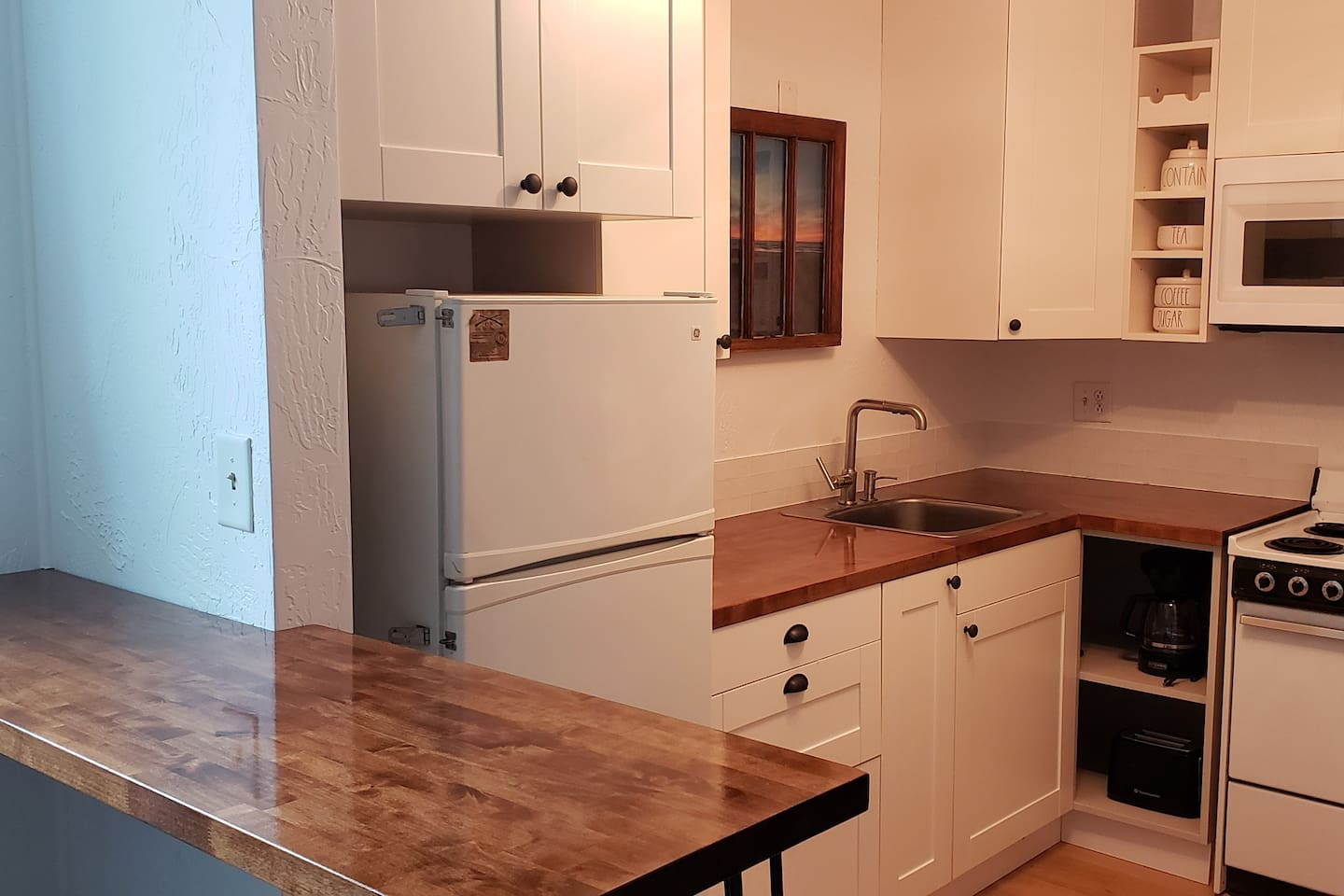 Newly remodeled fully equipped kitchen with eat at Island