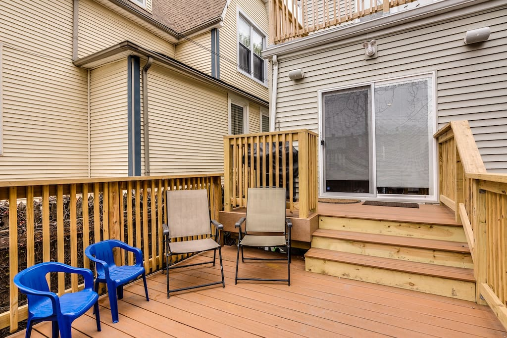 Sliding glass doors from kitchen lead you onto this brand new deck with grill.