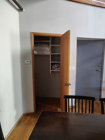 First floor closet near loft entrance, containing extra pillows and blankets for sofa bed.
