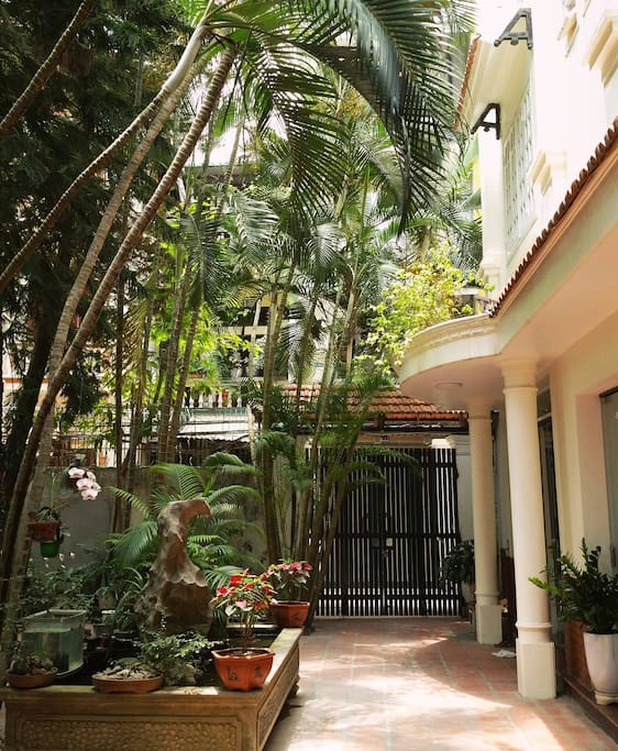 Shady entrance courtyard and French Indochina architecture