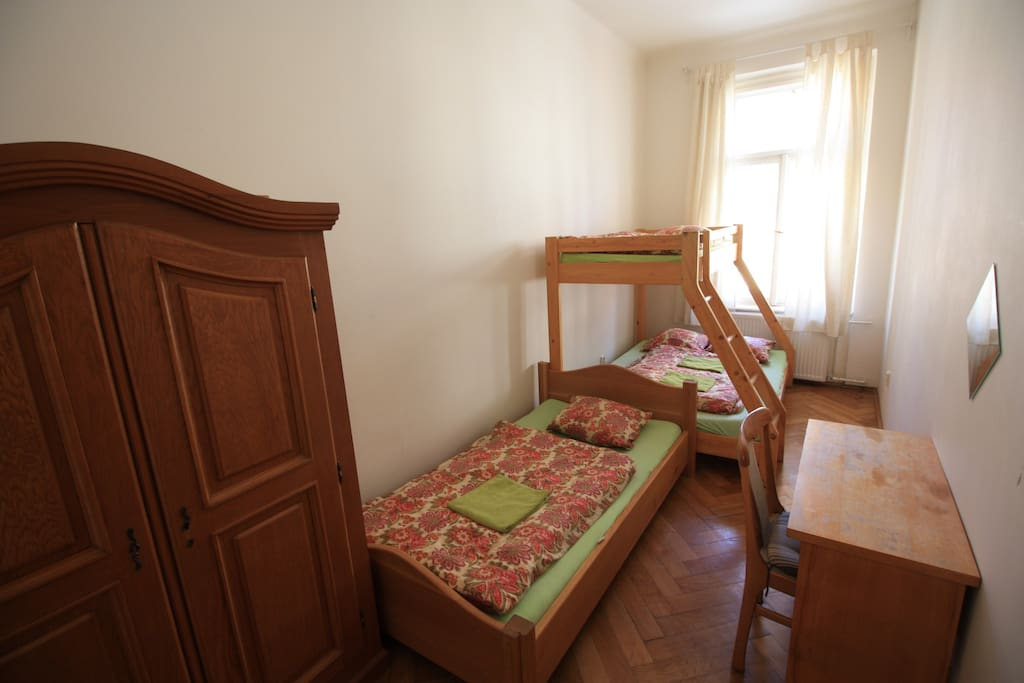 YOUR PRIVATE BEDROOM 1A arranged for 4 persons, writing desk  chair, wardrobe