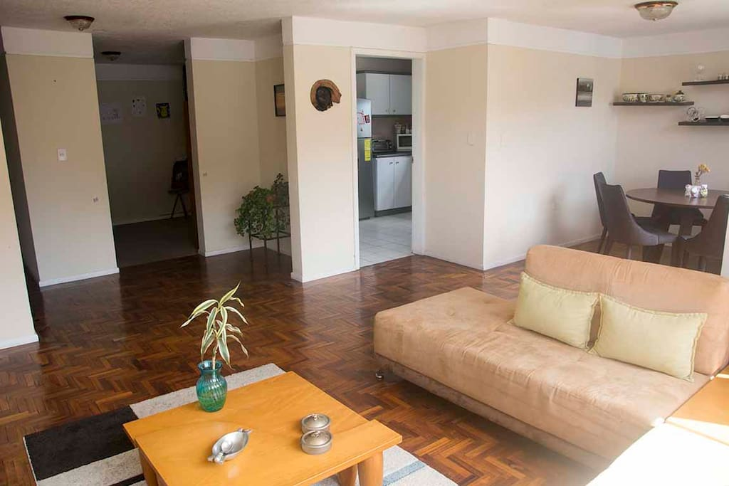 Ample and cozy living room with a view to the Pichincha Volcano.