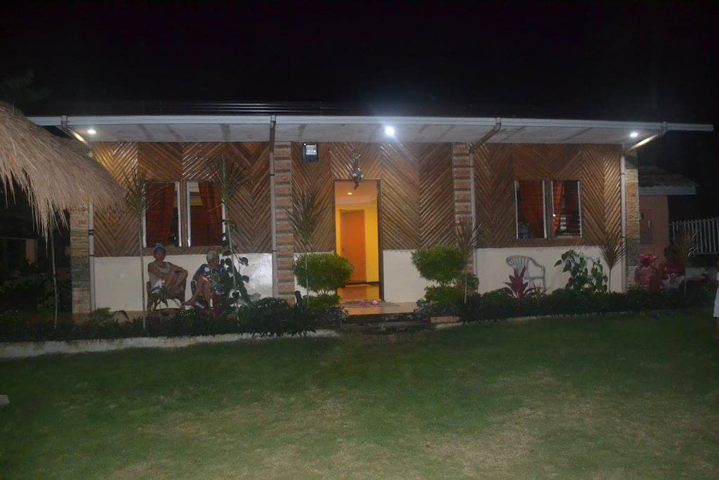Summer house at night - front view