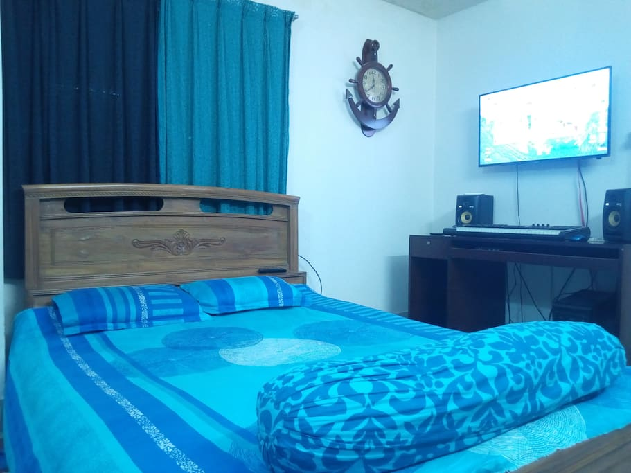 Bed room with LED TV and professional Sound System