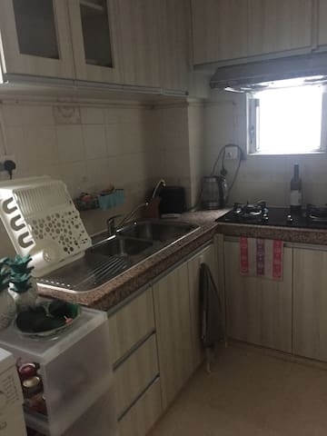 Spacious kitchen with full amenities including washing machine and dryer