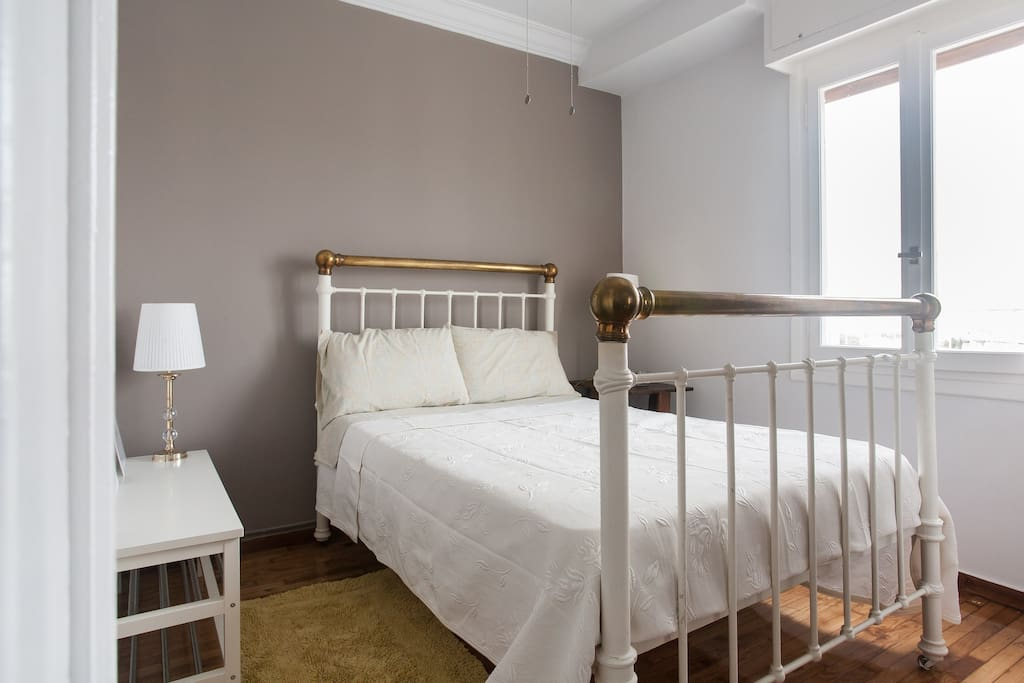 The bedroom features an old style brass double bed with a very comfortable mattress