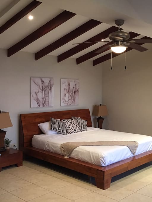 Upstairs Master Bedroom with en-suite bathroom, private balcony and ocean views