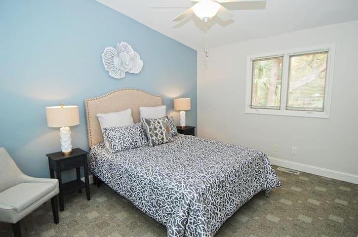 Bedroom upstairs with 1 queen bed