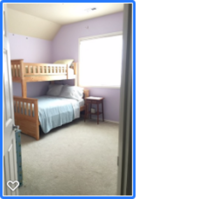 Room has a single over double bunk bed