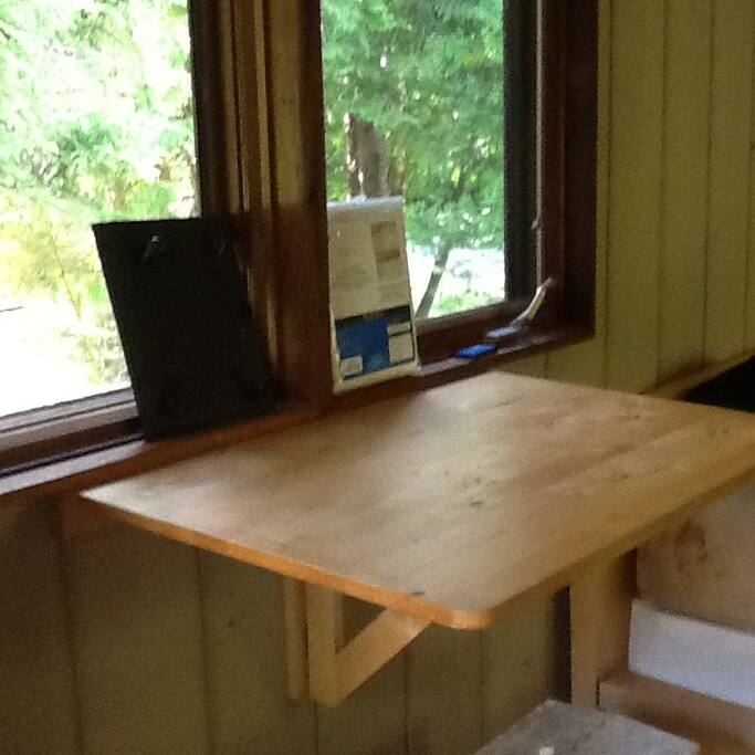 Small fold down table overlooking picnic area.