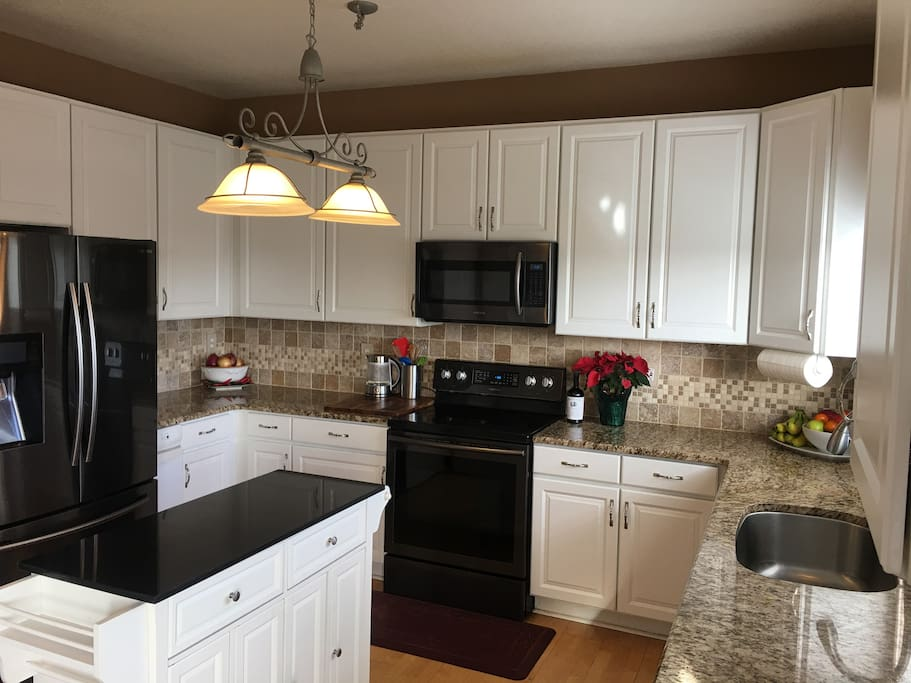 Spacious semi-custom kitchen with granite and new appliances.  Includes pantry that has limited food supplies.  Dry cereal, oatmeal, granola, and pastries are provided for breakfast.