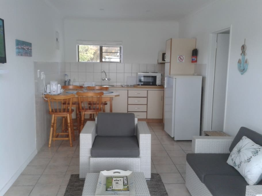 Suite 1. Open plan kitchenette and sitting room with TV