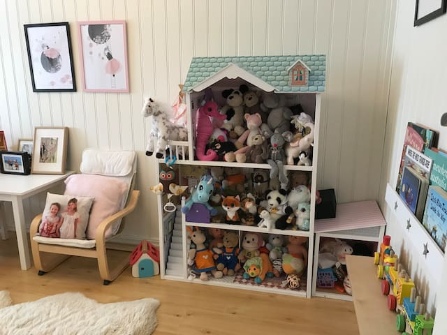 Kids room with lots of toys and books