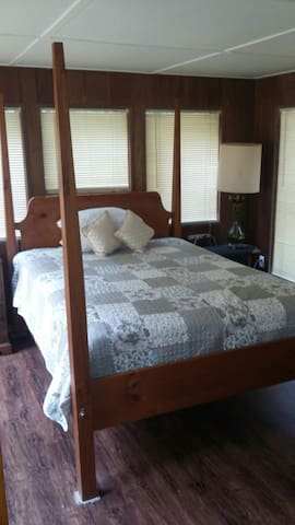 Master bedroom with dresser ,full mirror and queen bed