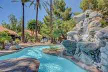 your condo  and patio overlooks this sparkling tropical pool. Relax  with  the sounds of the waterfalls.