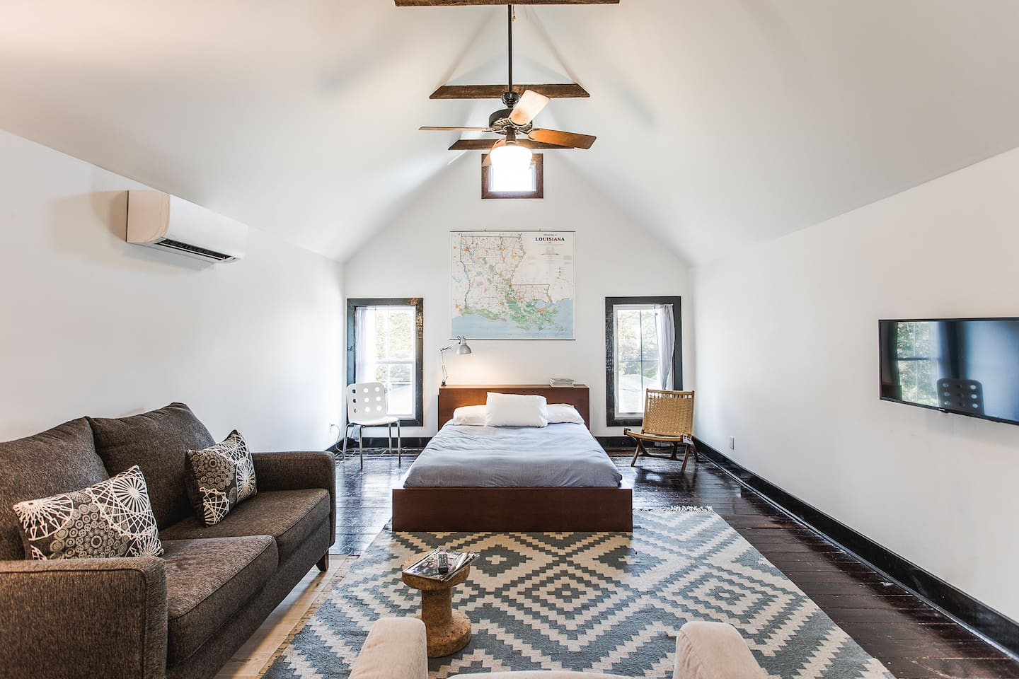 Fourteen foot ceilings with exposed beams in open loft space.