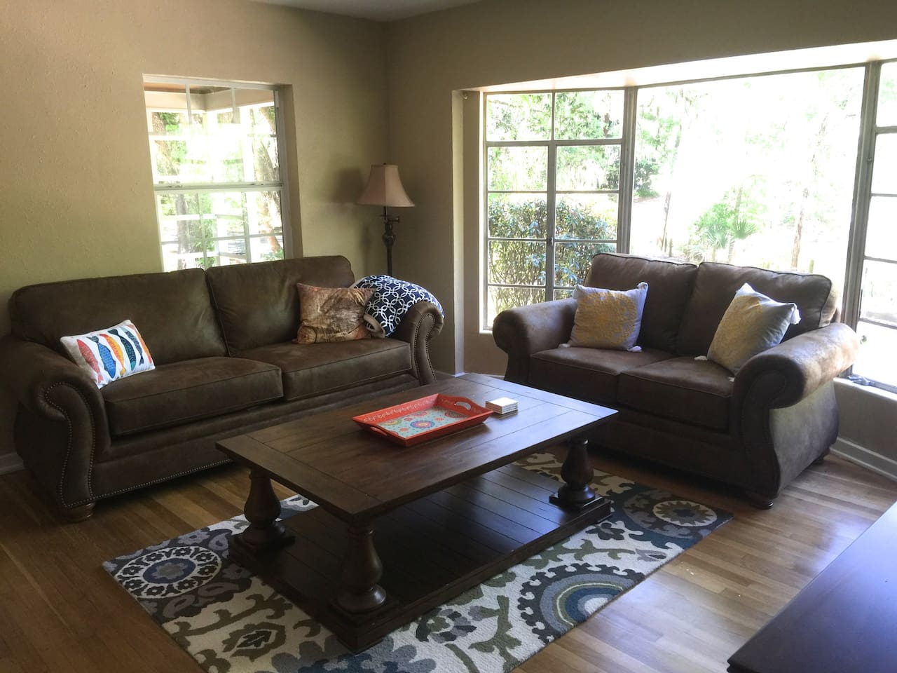 Living room with hardwood floors.  All furniture is brand new as of April 2016.  Sofa in living room has a pull out couch and an air mattress is offered as well if needed.