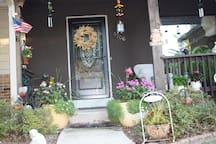 Front of my home.  As you can see, love flowers and kitties and dogs in that order