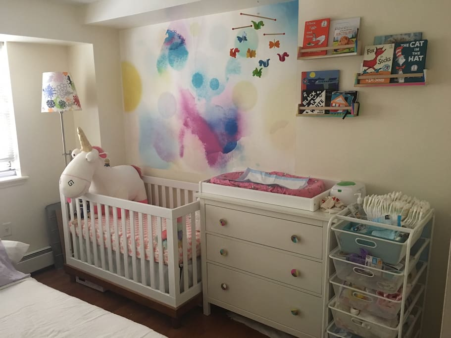 Second Bedroom is baby ready with full sized crib and queen sized