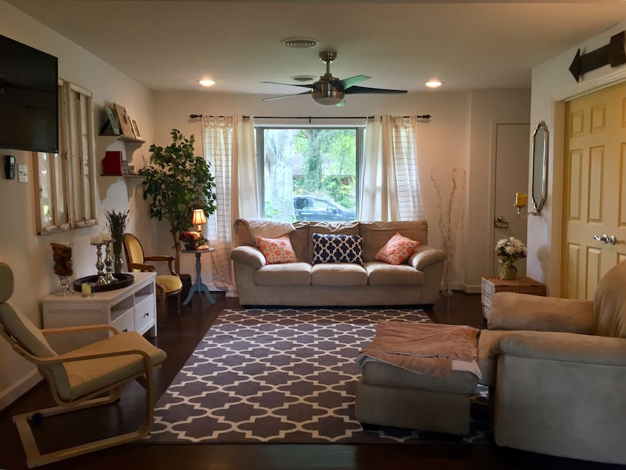 Bright, and open concept living room catering to fun and conversation.
