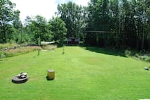 Large private garden with lots of outdoor toys.
