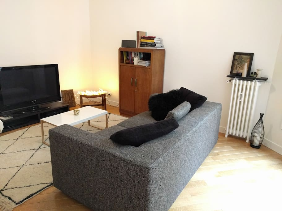 The living room, equipped with a TV set and cable TV (international channels available).