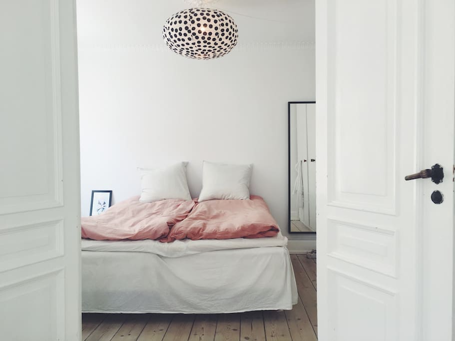 Bright and simple bedroom in with room for two adults. Bed is 180 x 200 cm.