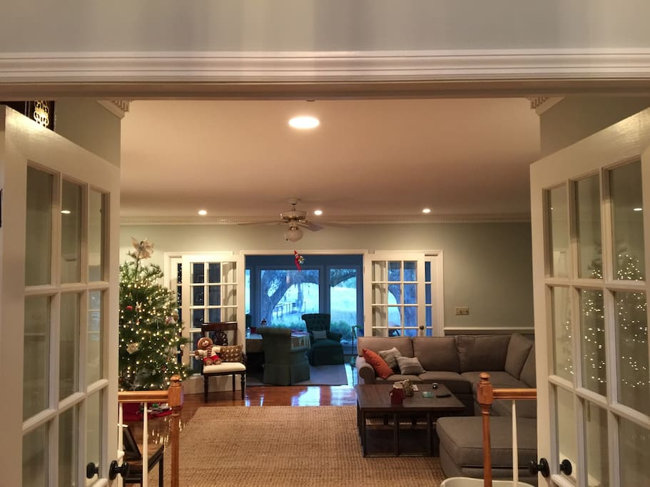 Living room and sunroom from entry foyer