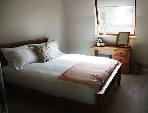 Bedroom overlooking the garden.