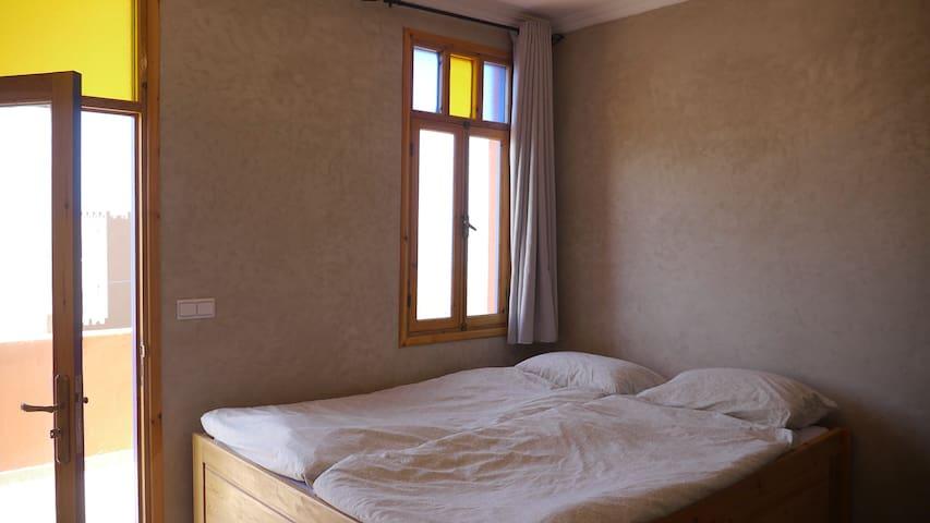 Bedroom with ocean-view and door to cozy private terrace