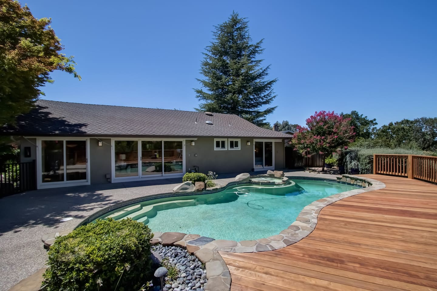 Pool, spa, deck, and sound system with outdoor speakers.