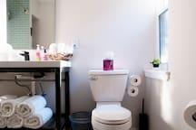 Fully stocked bathroom.