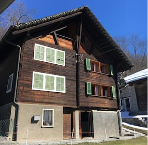Wooden chalet in the alps - Rossura