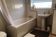 A bright, oak furnished, double bed & modern bath