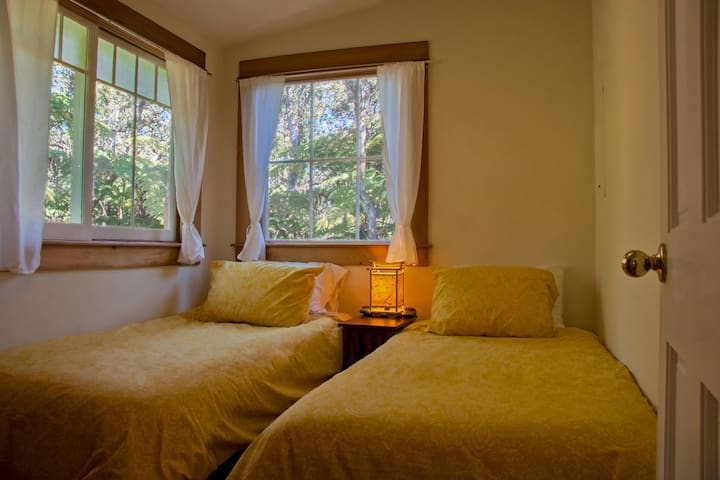 The second bedroom offers two cozy heated single beds, a small closet to hang up your clothes and lots of natural light.