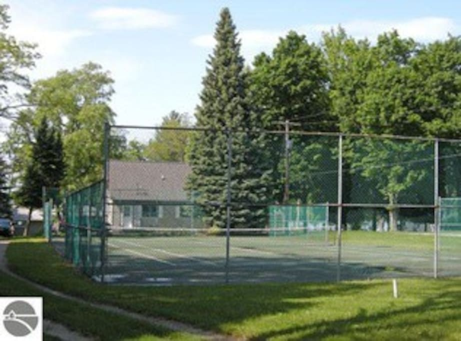 Private tennis court on the property