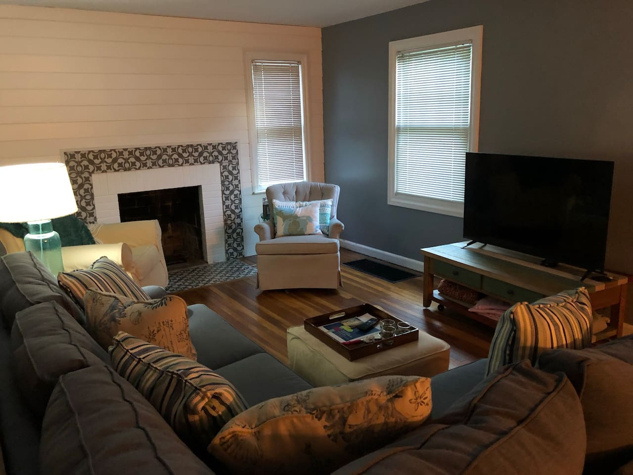 Living room with large sectional, TV with cable/Netflix/HBO, and room for queen air mattress