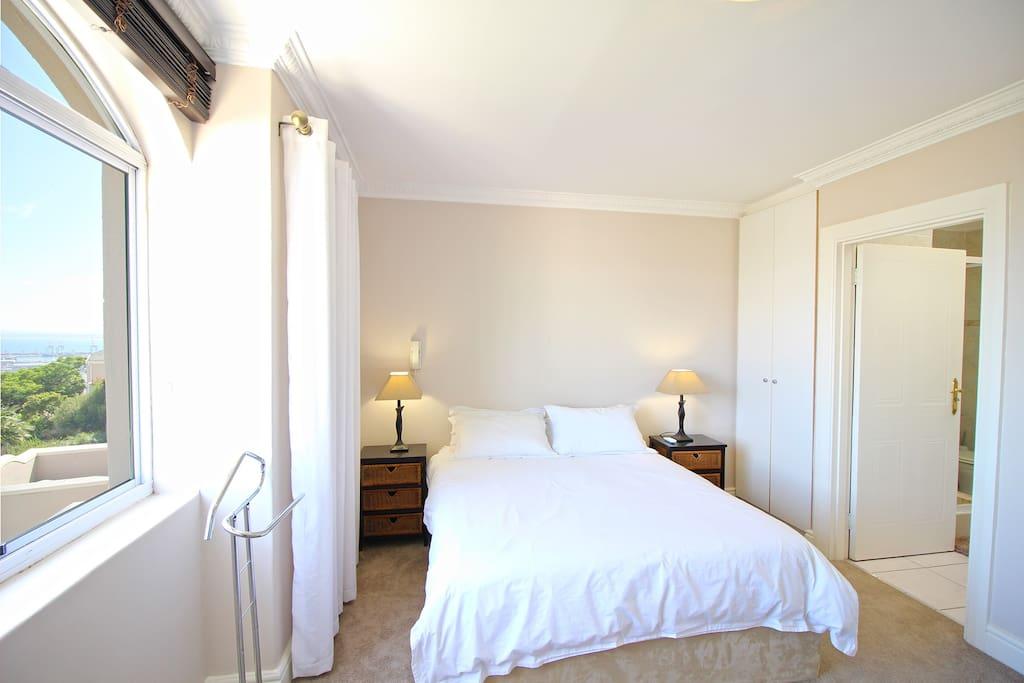 Master bedroom with comfortable queen bed and en-suite bathroom