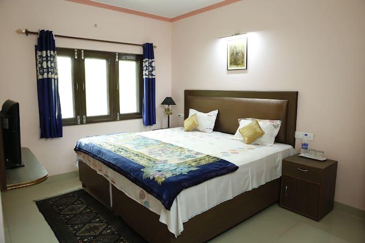 Apna Ghar with Garden view rooms