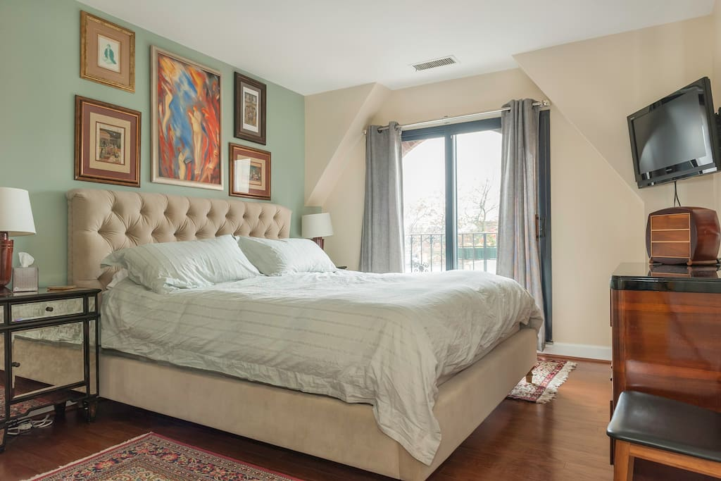 Master bedroom features a new Cal King Temperpedic bed, en suite bathroom and private Juliette  balcony