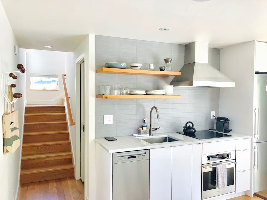 kitchen w/ high-end compact appliances including a dishwasher, induction cooktop and european convection oven