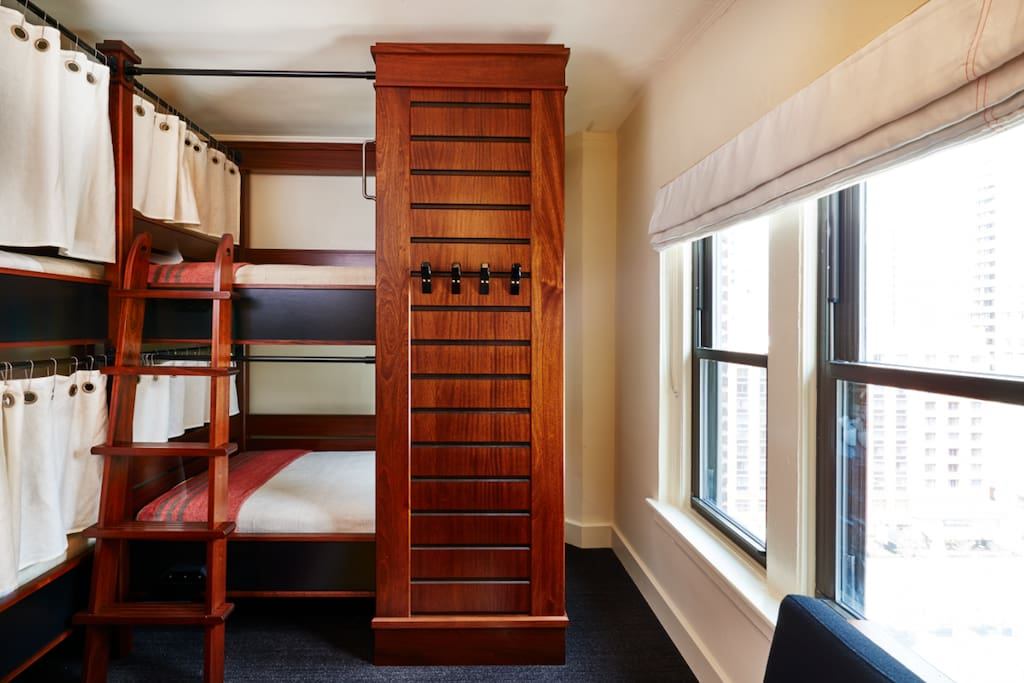 Our bunks are designed for privacy, each featuring a curtain, reading light, and power outlet.