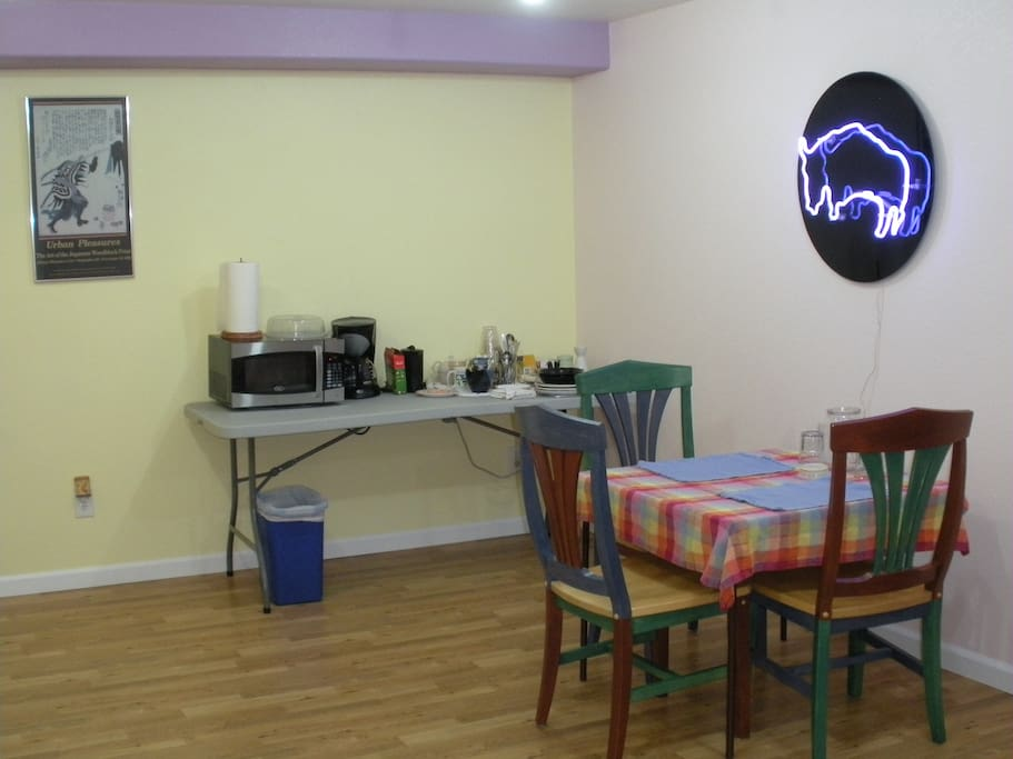 Dining area with amenities table and neon light