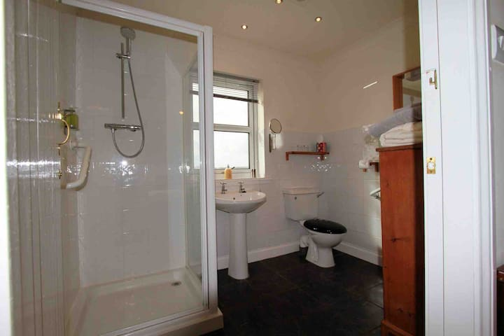En-suite shower room with view of Great Bernera and the hills of Lochs, Harris and Uig