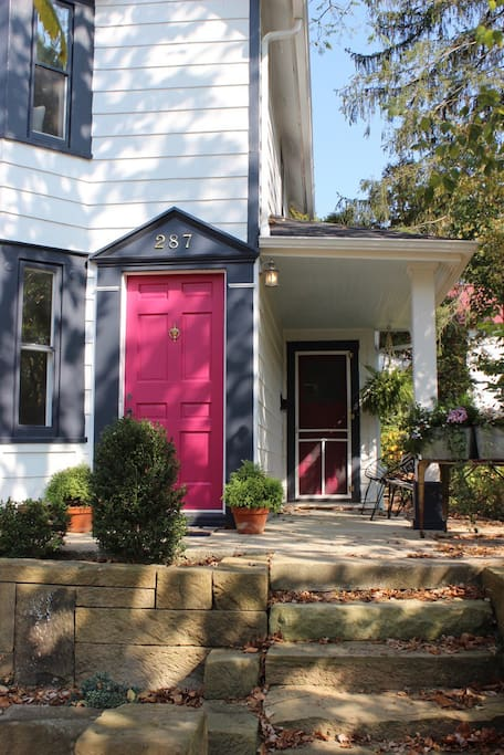 The cheery pink doors invite you to your stay!
