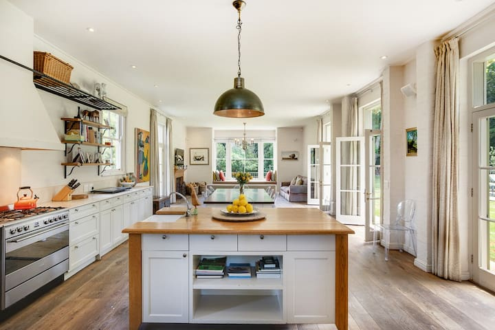 Open plan kitchen area with separate scullery