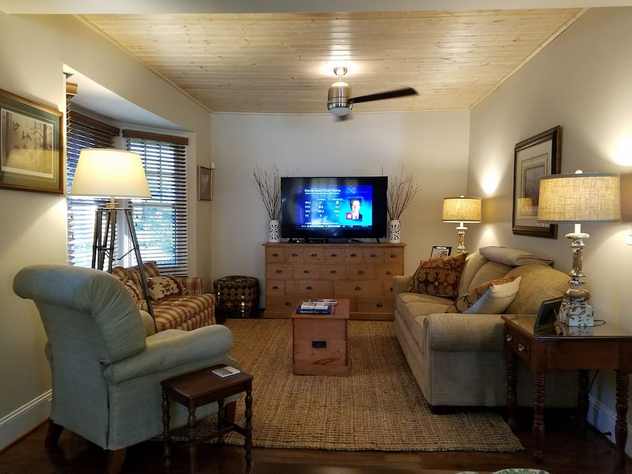"The den features a wood planked ceiling, oversized ceiling fan, and a 60"" HD Smart Television.  The sleeper sofa offers a queen sized 8"" thick inflatable mattress with memory foam top.  The room is the perfect gather place for everyone to relax and enjoy their visit."
