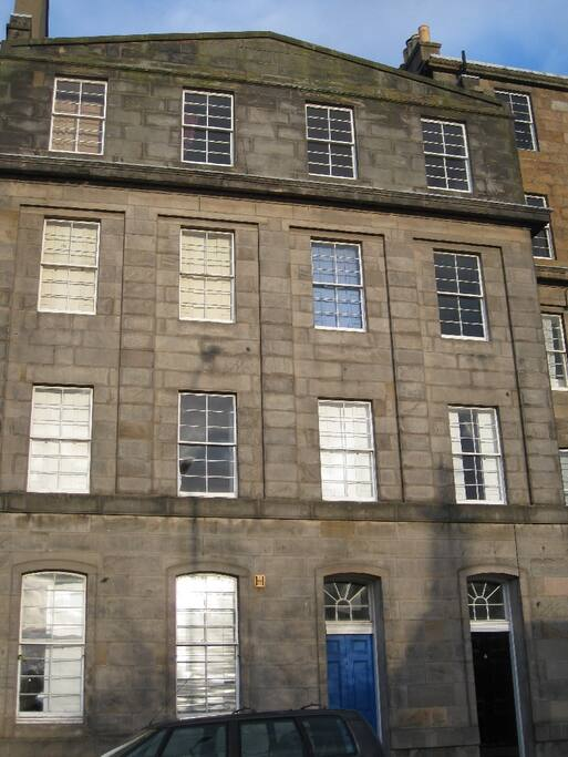 The flat is on the (UK) first floor - meaning the second floor in the US.  It's the best floor for combining easy access and privacy from the street. The exterior has characteristic 1820's-30's 'lying panes' (horizontal aspect glazing).