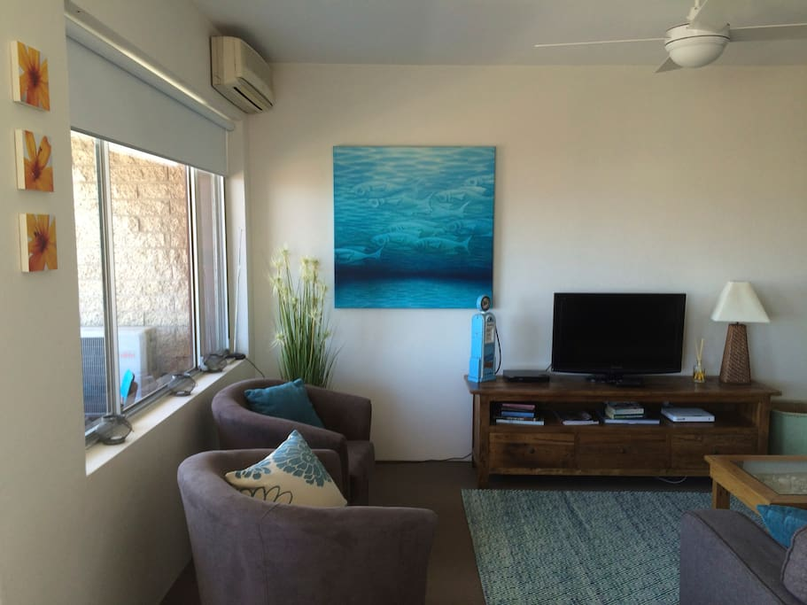 Comfortable and beachy living area with unlimited WIFI, large flat screen TV, DVDS, books and movies