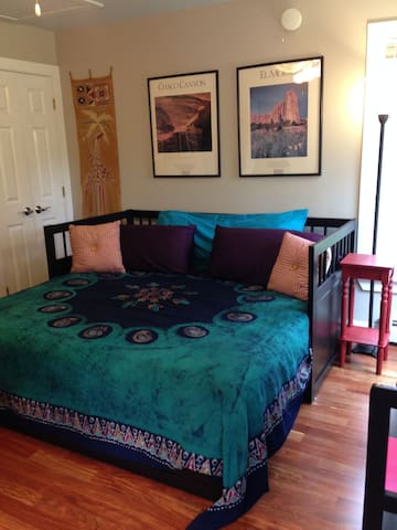 Bedroom in lovely condo in historic village
